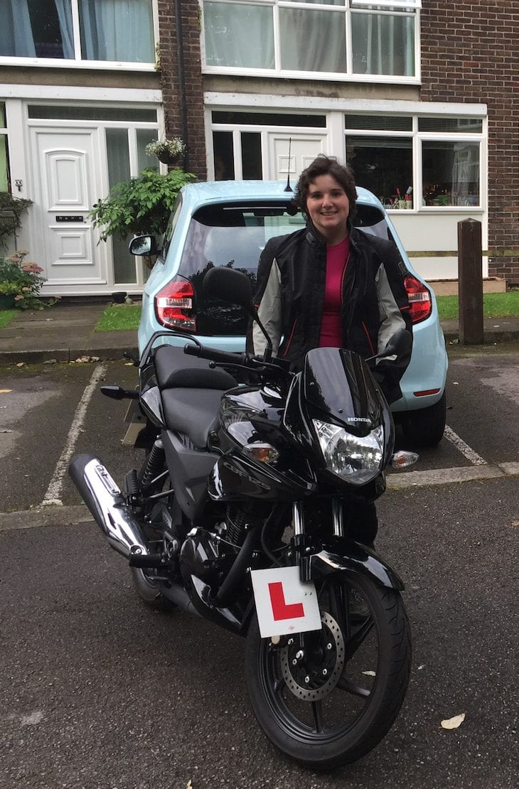 Natalia after her CBT ready for her first trip with her Honda CBF125 and her new Rev'It gear