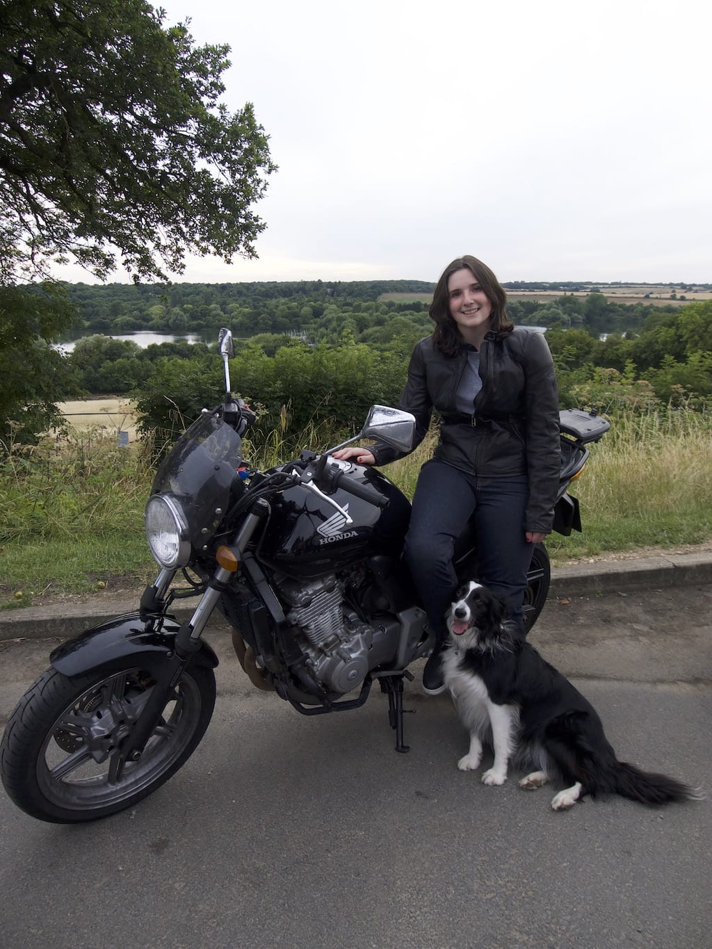Natalia posing with her Honda CBF500 wearing her new Knox jeans and Dainese leather jacket